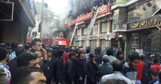 حريق بمحلات ملابس فى الموسكى وسيارات الإطفاء تحاول إخماده