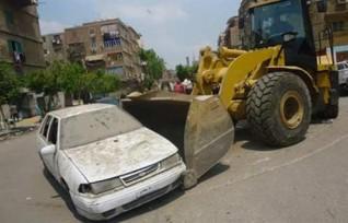 ضبط 10 سيارات ودراجات بخارية متروكة بالشوارع خلال حملات بالجيزة