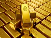 الذهب ينخفض مع إرتفاع الدولار والسندات ورغم مخاوف النمو